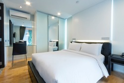 luxury white bedroom in apartment.