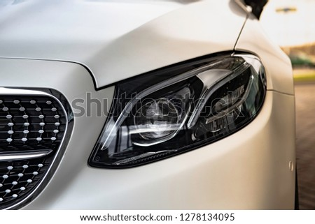 luxury white car. sunlight. front view