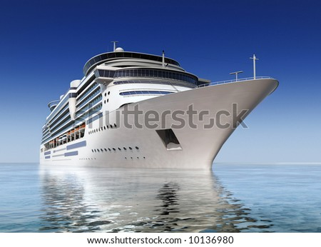 luxury white cruise ship shot at angle at water level on a clear day with calm seas and blue sky