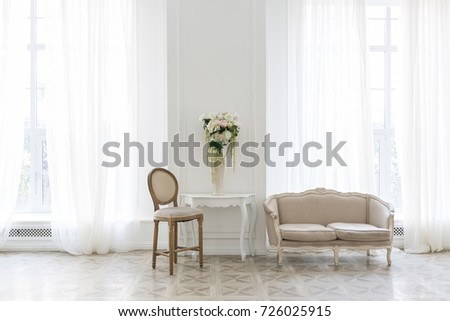 Luxury white interior of living spacious room with elegant chic furniture and high windows. #726025915