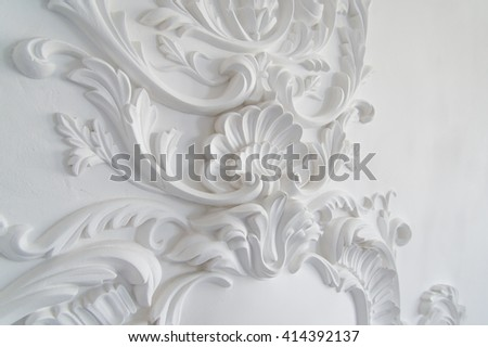 Luxury white wall design bas-relief with stucco mouldings roccoco element. Elements of torsel ornament for use as a texture or background