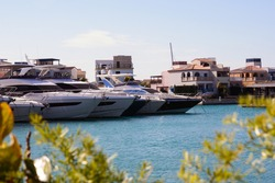 Luxury white yachts against the blue sky in the harbor of the port of Limassol Marina, Cyprus.