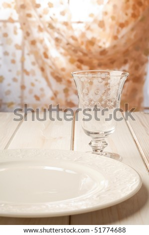 luxury wine glass and dish on table selective focus on glass