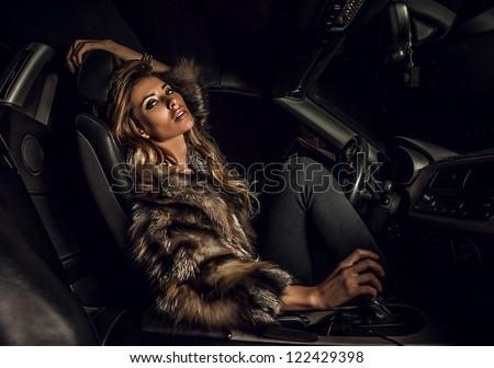 Luxury woman in a car.