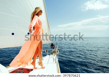 luxury woman pareo yachting boat trip in sea with blue sky sunlight #397870621
