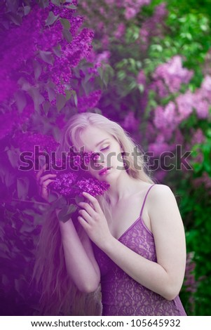 Luxury woman with a lilac flowers.