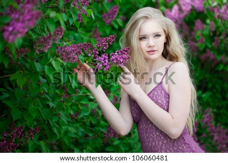 Luxury woman with a lilac flowers. - stock photo