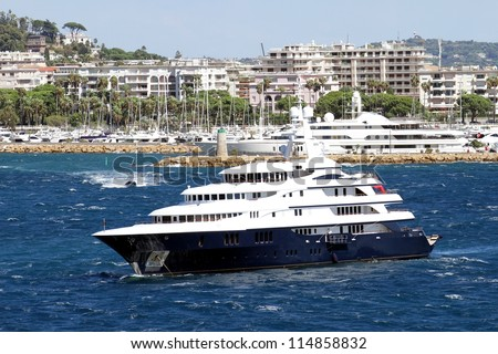 Luxury yacht anchored close to Cannes port, France.