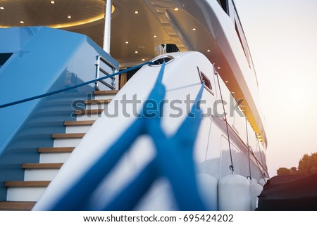 Luxury yacht anchored in the port. View of entrance and seaside.