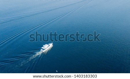 luxury yacht sailing on opened sea. aerial view. drone shot. picture with space for text #1403183303