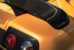Luxury yellow sports car fragment, rear aerodynamics carbon spoiler and rear lights