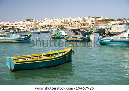 luzzu fishing maltese boats in harbor of marsaxlokk old fishing village malta mediterranean sea