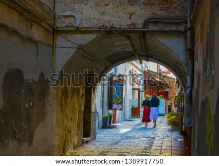 Lviv, Lviv/Ukraine – September 15 2017: A pair of tourists walking through the old town. #1389917750