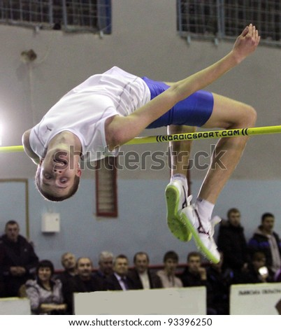 LVIV,UKRAINE-JAN. 20: Zaskalko Evgen from Kiev competes in high jump competition with result 2.18 on the International Memorial Demyanyuk track and field meeting, on January 20, 2012 in Lviv, Ukraine