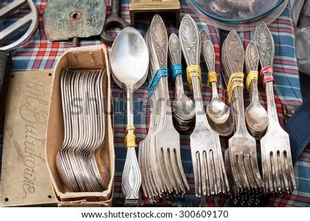Lviv, Ukraine - July 12, 2015: Vintage silverware for sale on a flea market.