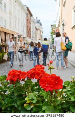 LVIV, UKRAINE - JUNE 29, 2015: cityscape of Lviv downtown, summer flowers and people
