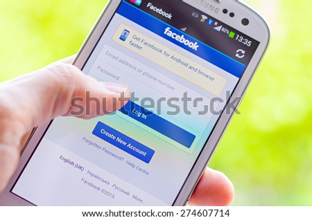 LVIV UKRAINE May 03 2015 White Smart Phone with Facebook Social Network Log In Screen