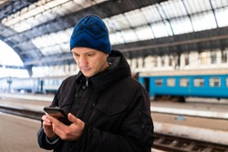 Lviv, Ukraine with man inside Lvov train station platform in historic Ukrainian city with cold winter weather in winter travel vacation