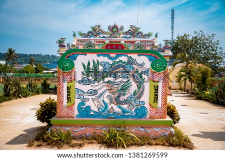 Ly Son island, VIETNAM - APR 15, 2019: colorful temple with blue sky at Ly Son Island, Quang Ngai Province, Vietnam  #1381269599