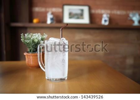 lychee soda on wood background