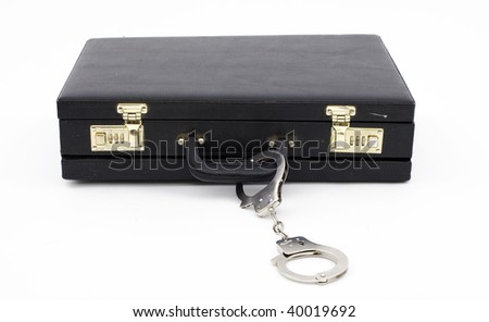 lying black suitcase from pinned handcuffs, white background