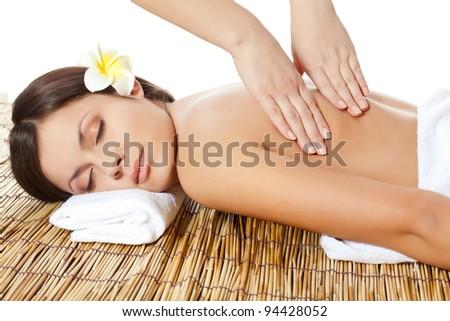 lying brunette woman receiving massage of head