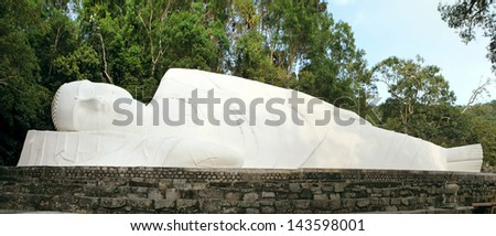 Lying Buddha statue on the mountain Ta Ku. Vietnam