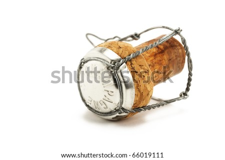 lying cork from a champagne bottle on white background