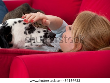 lying on red sofa young woman with dalmatian dog