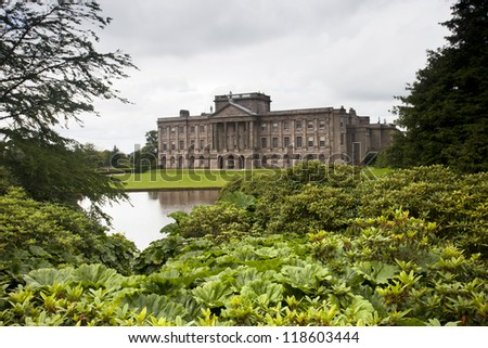 lyme park mansion manor house on a cloudy day