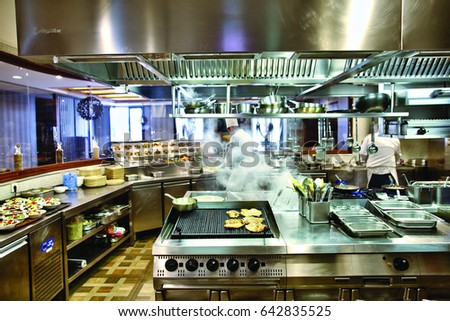 Lyon, France - 12 April 2017 - The chefs prepare food in the industrial kitchen.