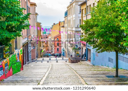 LYON, FRANCE, JULY 22, 2017: People are strolling through a narrow street in the historical center of Lyon, France