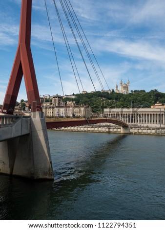 LYON, FRANCE - May, 2018: Perfect bridge across river Rhone on winter sunny day, Lyon, France