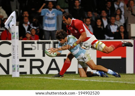 LYON, FRANCE-SEPTEMBER 12, 2007: argentinian rugby player, Lucas Borges, scores a try, during the rugby match Argentina vs Georgia, of the Rugby World Cup, France 2007, in Lyon.
