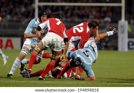 LYON, FRANCE-SEPTEMBER 12, 2007: rugby players scrum, during the rugby match Argentina vs Georgia, of the Rugby World Cup, France 2007, in Lyon.