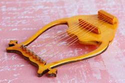 lyre - stringed plucked musical instrument . A symbol of poetry, poetic creativity, and poetic inspiration.