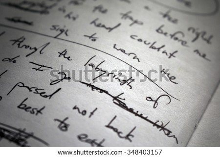Shutterstock Lyrics scribbled on white paper. Focus on the word
