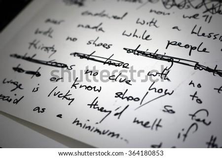 Shutterstock Lyrics written in ink on paper, closeup/focus on the words