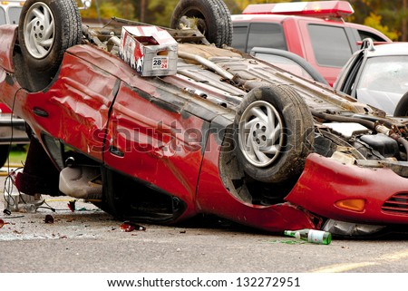 M'CHIGEENG, ONTARIO, CANADA-OCTOBER 1: Mock  car accident scene coordinated by police, fire, ambulance, and victim services, to educate students on the dangers of impaired driving, on October 1, 2008. M'Chigeeng, Ontario