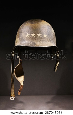 M1 combat helmet. A World War Two period American U.S. Army soldier's steel combat helmet with four-star insignia of the rank of General on it.