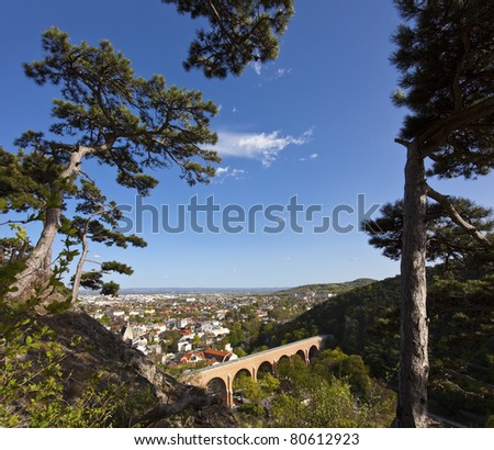 "Mödling (Lower Austria) and his famous aqueduct Built in the 18th century. The aqueduct is part of the First Viennese mountain spring water supply line. View from mountain ""Kalenderberg"" - stock photo"