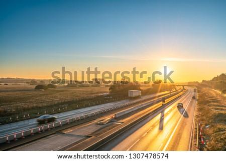 M1 motorway at sunrise. England  #1307478574