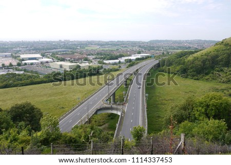 M20 Motorway overpass with town and sea in background