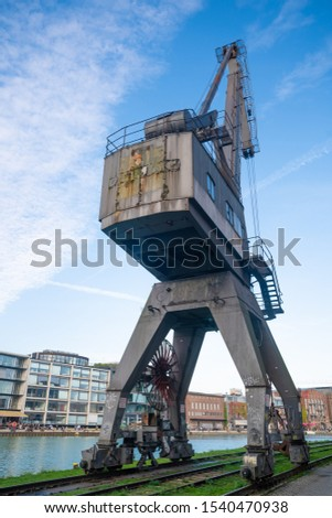 Münster / Germany - Oct. 13, 2019: Old harbor crane in the harbor of Münster, Germany. #1540470938