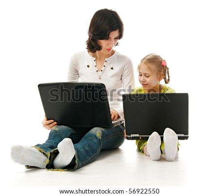 ma and child with laptops on white background