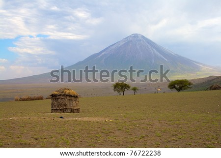 Maasai house with volcano on background, Tanzania