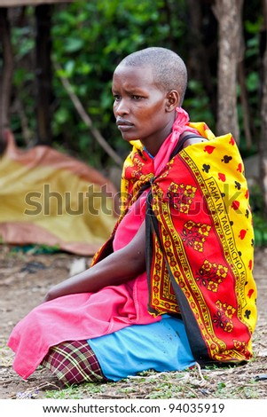 MAASAI MARA, KENYA-AUG 18: Portrait of unidentified Maasai woman on Aug 18, 2011 in Maasai Mara, Kenya. Maasai are a Nilotic ethnic group of semi-nomadic people located in Kenya and Tanzania.