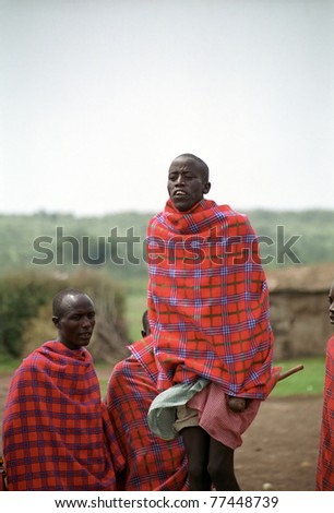 MAASAI MARA, KENYA - FEBRUARY 4: Maasai morani's numba dance, 4 February , 2004 at Masaai Mara, Kenya. The Maasai are the most famous tribe in Africa. They are nomadic and live in small villages.