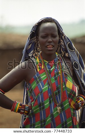 MAASAI MARA, KENYA - FEBRUARY 4: Maasai woman in the village, 4 February , 2004 at Masaai Mara, Kenya. The Maasai are the most famous tribe in Africa. They are nomadic and live in small villages.