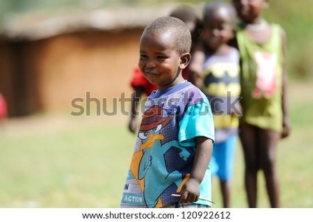 MAASAI MARA, KENYA - NOVEMBER 10: Group of unidentified African children on November 10, 2012 in Maasai Mara, Kenya. Maasai are a Nilotic ethnic group of semi-nomadic people located in Kenya.